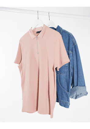 ASOS DESIGN short sleeve polo in waffle with zip in pink