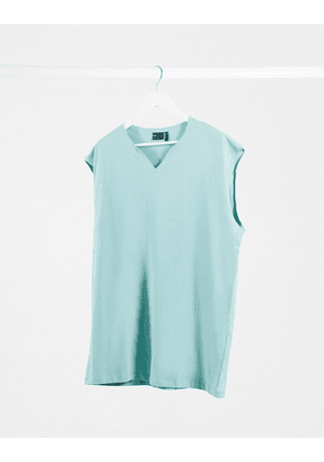 ASOS DESIGN oversized longline sleeveless t-shirt with notch neck in green