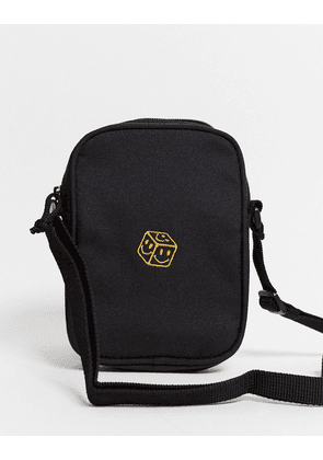 ASOS DESIGN flight bag in black with yellow embroidery