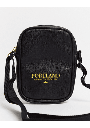 ASOS DESIGN flight bag in black faux leather with 'Portland' text embroidery