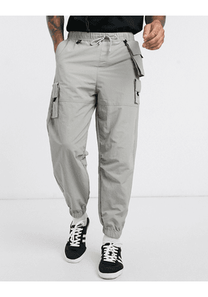 ASOS DESIGN oversized tapered joggers in grey with detachable pockets