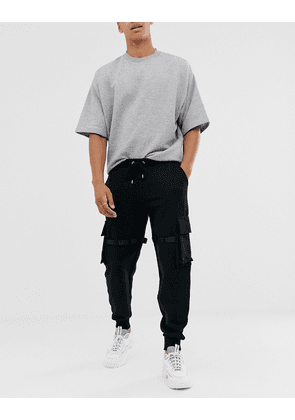 ASOS DESIGN utility joggers with multi pockets & strapping-Black