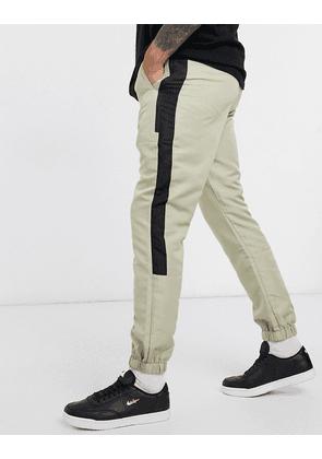 ASOS DESIGN tapered cargo joggers with elasticated waist in nylon-Purple