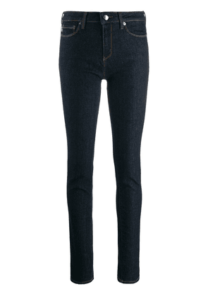 Love Moschino heart-shaped plaque skinny jeans - Blue