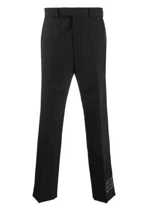 Gucci logo-patch cropped trousers - Black