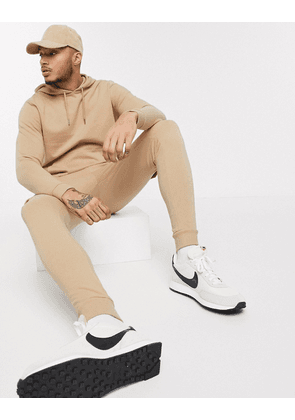 ASOS DESIGN tracksuit with hoodie & skinny cargo joggers in beige