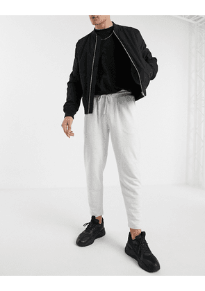 ASOS DESIGN organic tapered joggers with pleats in white marl