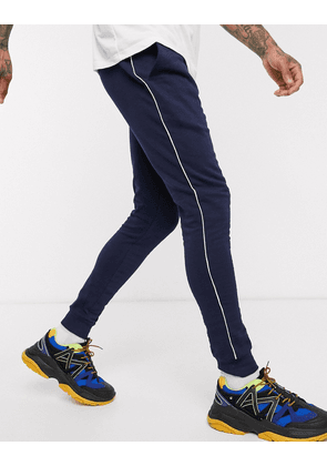 ASOS DESIGN ORGANIC super skinny joggers with piping in navy