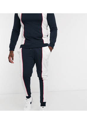 ASOS DESIGN Plus co-ord super skinny joggers in retro sport colour block with piping-Navy
