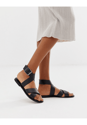 ASOS DESIGN Flossy leather cross strap flat sandals-Black