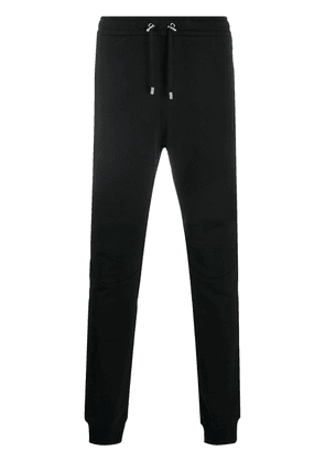 Balmain slim fit metallic logo print track pants - Black