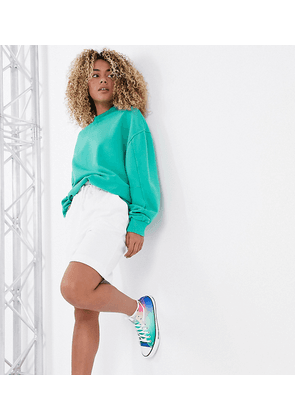 COLLUSION longline jersey shorts in white