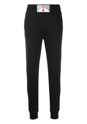 Love Moschino logo patch track trousers - Black