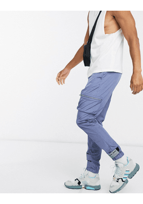 ASOS DESIGN tapered joggers with text print-Blue