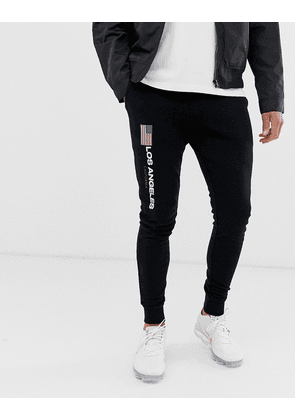 ASOS DESIGN skinny joggers with Los Angeles flag print-Navy