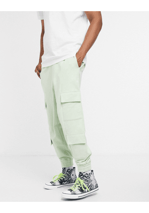 ASOS DESIGN oversized cargo joggers in washed green