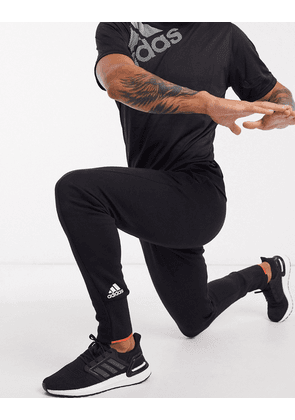 adidas VRCT trousers in black & semi solar red