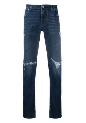 Dolce & Gabbana logo plaque distressed jeans - Blue