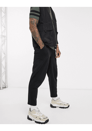 ASOS DESIGN organic tapered joggers with pleats in black