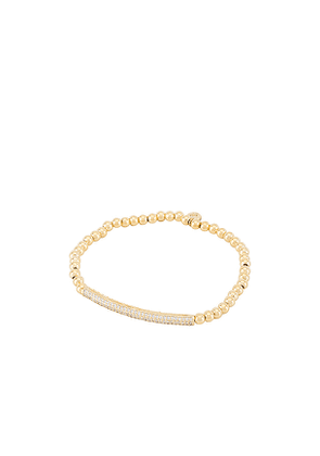 TAI Jewelry Beaded Stretch Bracelet with Pave Bar in Metallic Gold.