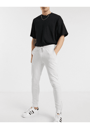 ASOS DESIGN organic super skinny joggers in white marl with silver zip cuffs