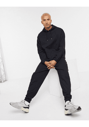 ASOS DESIGN organic oversized tracksuit with hoodie & relaxed joggers in black