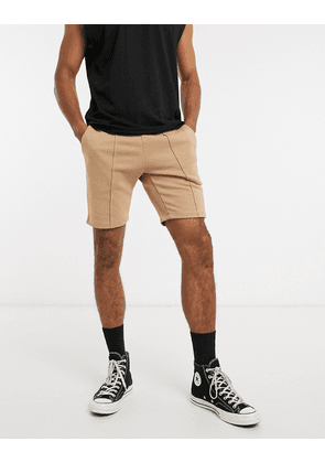 ASOS DESIGN co-ord jersey skinny shorts with pin tucks in brown