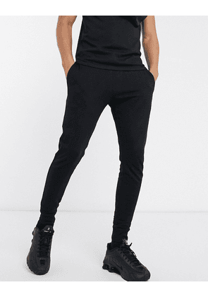 ASOS DESIGN skinny lightweight joggers in black