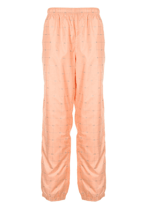 Supreme logo grid tapered trousers - ORANGE