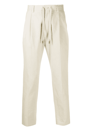 Dolce & Gabbana front-tie tapered trousers - NEUTRALS