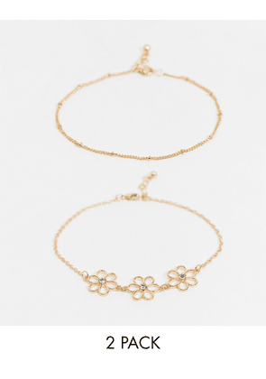 ASOS DESIGN pack of 2 anklets with cut out daisy charms in gold tone