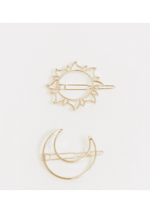 ASOS DESIGN pack of 2 hair clips in sun and moon design in gold tone