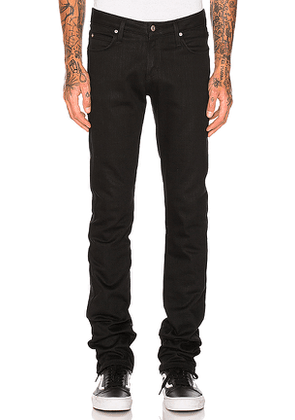 Naked & Famous Denim Skinny Guy Black Power Stretch in Black. Size 28.