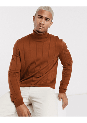 ASOS DESIGN knitted wide rib roll neck jumper in brown
