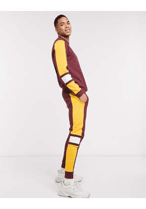 ASOS DESIGN co-ord skinny joggers in burgundy with mustard & white side tape-Red