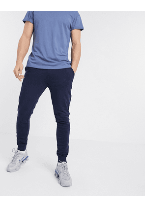 ASOS DESIGN organic super skinny joggers in navy with silver zip cuffs