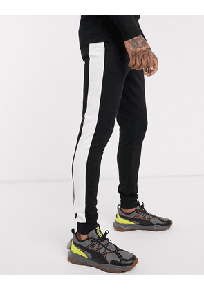 ASOS DESIGN ORGANIC skinny joggers with side stripe in black