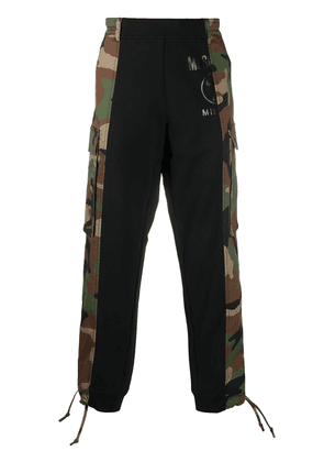 Moschino camouflage panel track pants - Green