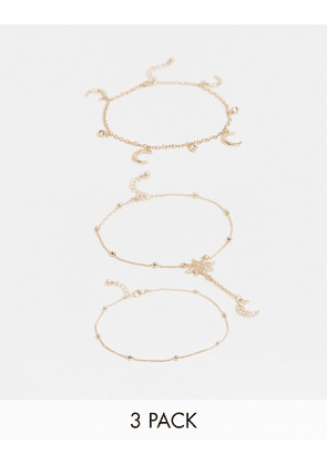 ASOS DESIGN pack of 3 anklets with crystal star and moon charms in gold tone
