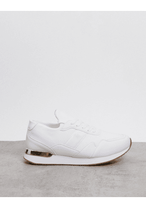 ASOS DESIGN trainers in white with gold detail
