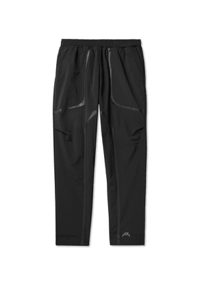A-COLD-WALL* - Tapered Nylon Trousers - Men - Black