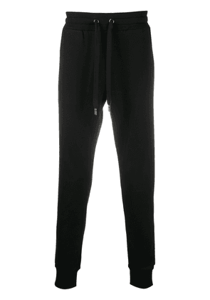 Dolce & Gabbana logo-embroidered cotton track pants - Black