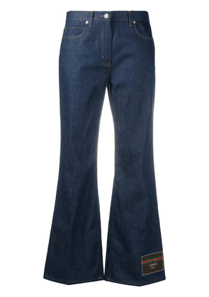 Gucci flared jeans with logo patch at leg - Blue