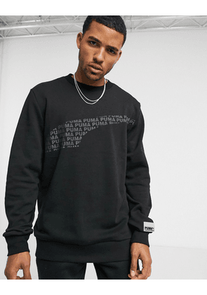 Puma Avenir graphic jumper in puma black