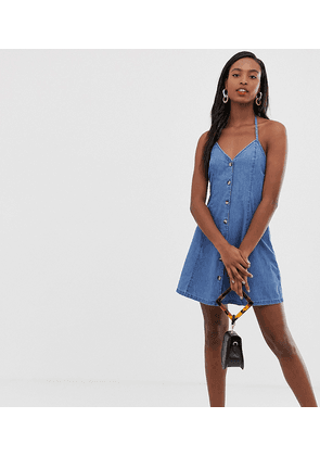 ASOS DESIGN Tall denim halter neck mini dress with buttons in midwash blue