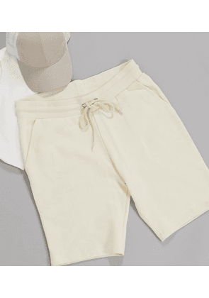 ASOS DESIGN Tall jersey skinny shorts in beige