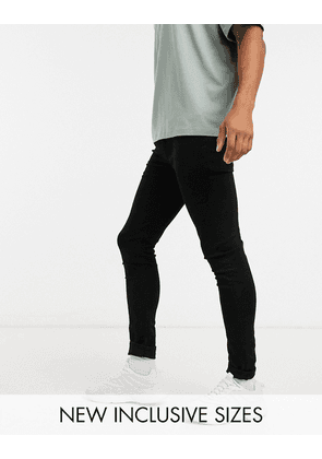 ASOS DESIGN spray on jeans with power stretch in black