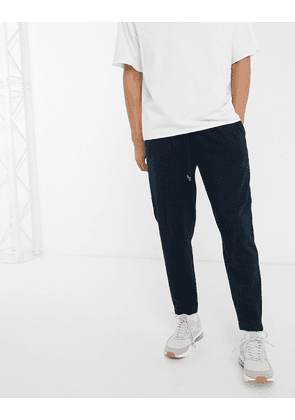 ASOS DESIGN tapered joggers with pleats in navy