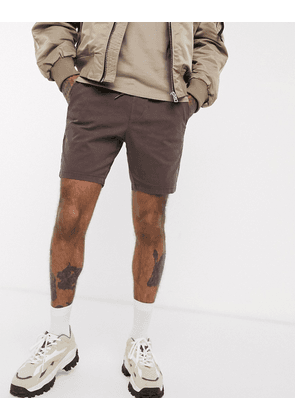 ASOS DESIGN skinny chino shorts with elastic waist in washed brown