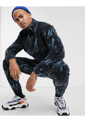 ASOS DESIGN co-ord slim joggers with camo fleece and nylon panels-Blue